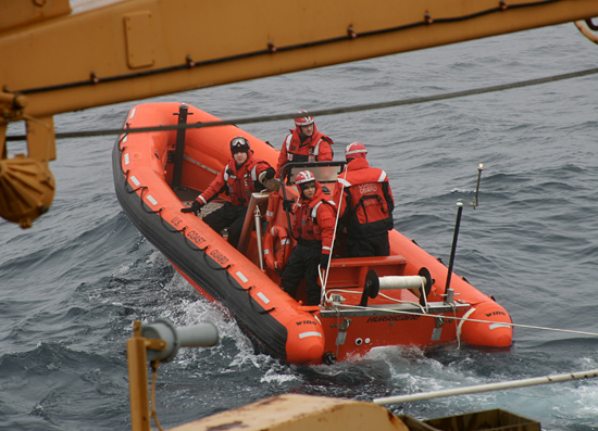 Team from USCGC Healy departing on a Hurricane tender.