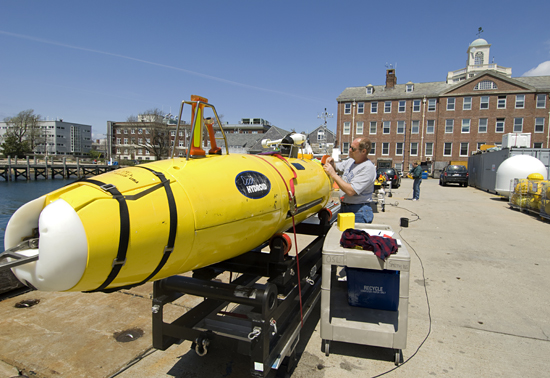 Engineer Bob Elder prepares the REMUS 6000 autonomous underwater vehicle for testing in the harbor of Woods Hole in May 2008. The AUV is headed to Estonia this summer for deep-ocean survey work in the Baltic Sea and other northern European waters.