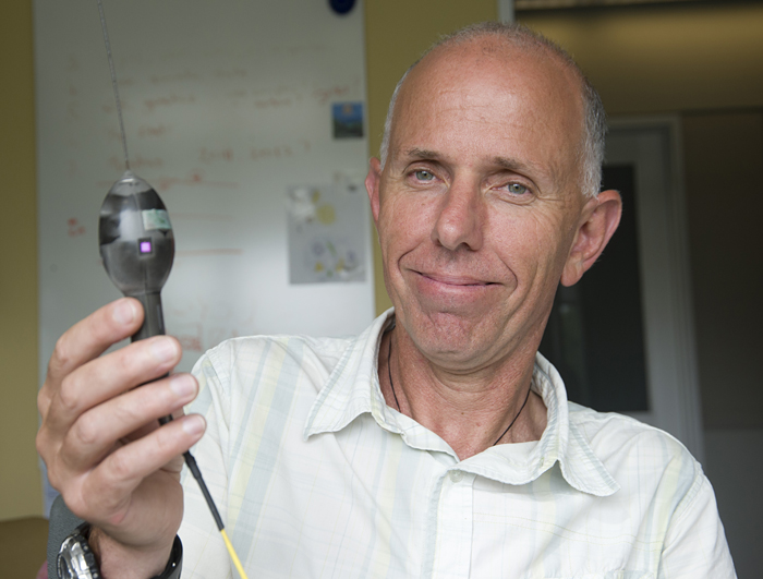 Scientist Thorrold with shark tag