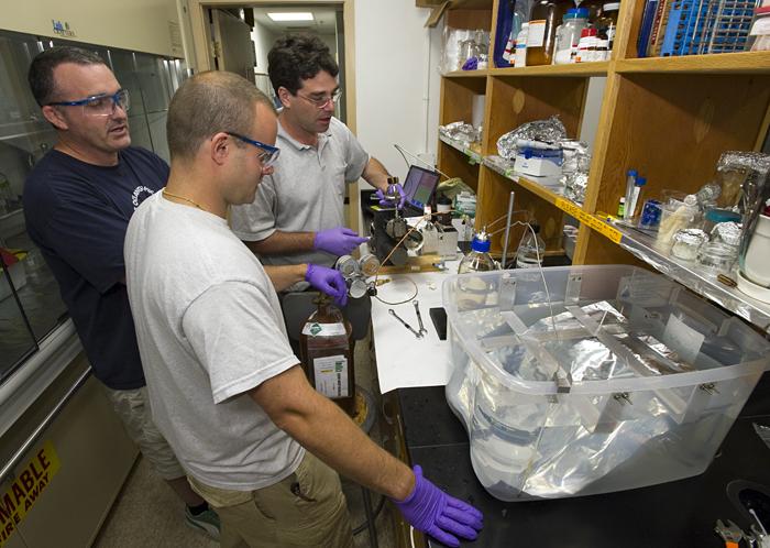 Reddy, Sylva, and Seewald retrieving sample of Deepwater Horizon oil from Seewald sampler