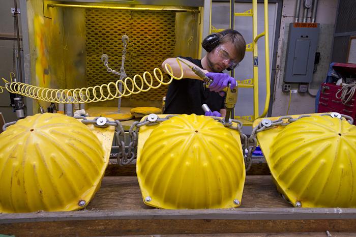 Matthew Adams works on hardhat floats