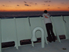 Nika Staglicic on open deck watching the sunrise on the LADDER 3 cruise.