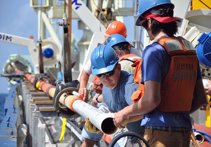 a liner of PVC pipe being inserted into WHOI's long corer