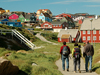 Sarah Das, center, and colleagues entering a village during the July 2007 expedition to Greenland.