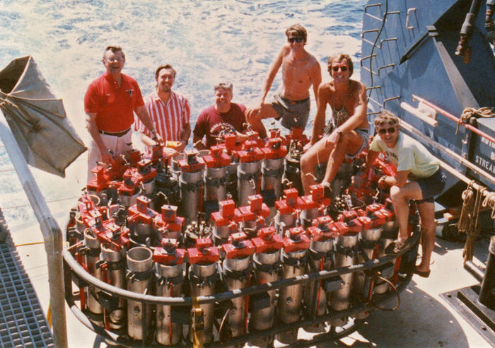 group of engineers pose with NOBEL system of seafloor explosive charges