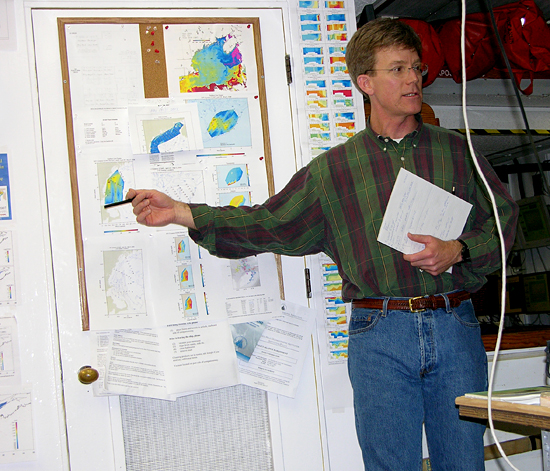 Dennis McGillicuddy reviewing data during cruise.
