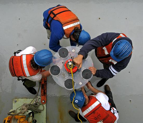 sediment trap being emptied