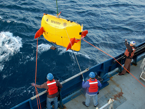 crew aboard the R/V Atlantis launch the autonomous underwater vehicle (AUV) Sentry during a September 2009 cruise