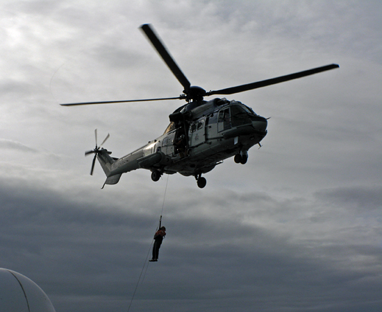 Pete Liarikos, Bosun on the Knorr, rises into an Icelandic coast guard helicopter during cruise KN189-04.