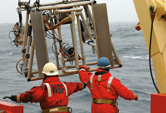 Researchers and crew aboard the R/V Laurence M. Gould recover a new Large Area Plankton Imaging System (LAPIS) after a test in Antarctic waters in March 2006.