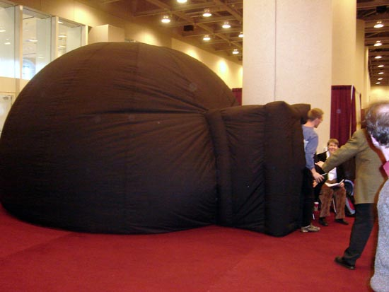 Scientists exit the inflatable planetarium