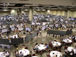 500 posters cram a cavernous meeting hall