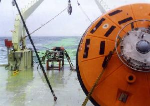 Fluorescein dye (green) rinsed from the deck and the systems is seen in the Oceanus's wake.