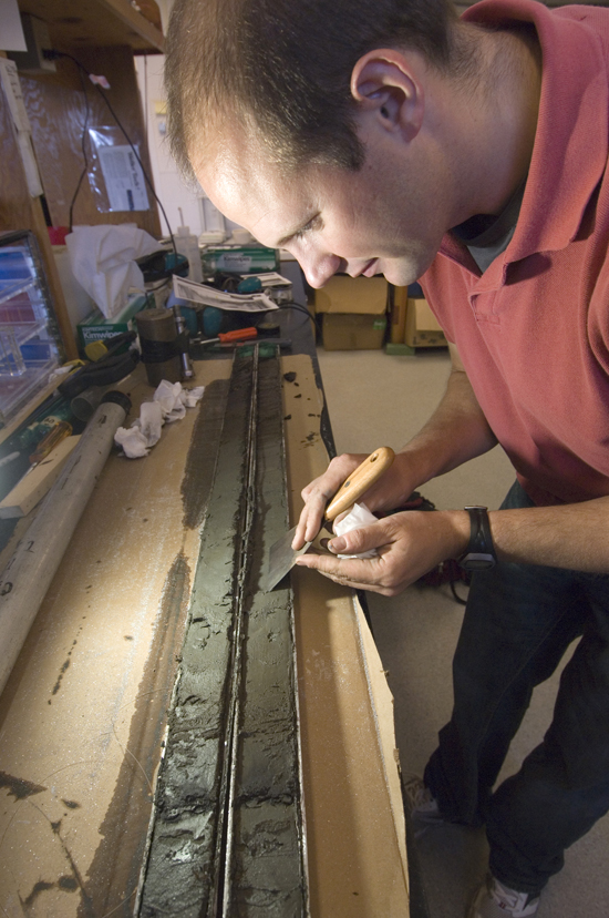 Jon Woodruff examining sediment core