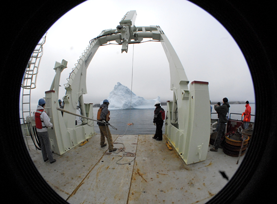 R/V Knorr backing up to an iceberg off the coast of Baffin Island