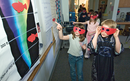 Tinted glasses and a darkened classroom helped fourth-graders experience how bright red fish exploit colors and lack of light to avoid predators.