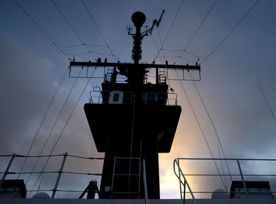 The conning station of the USCGC Healy in the sunrise.