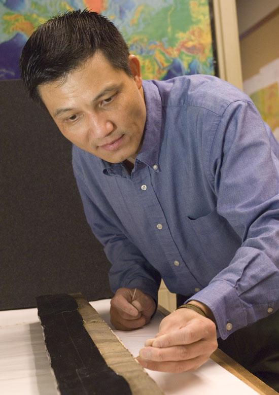 Jian Lin working with a core sample from the 2005 tsunami area.