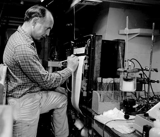 Stanley W. Watson monitors the oxygen uptake of microbes in a seawater  sample during R/V Chain cruise.
