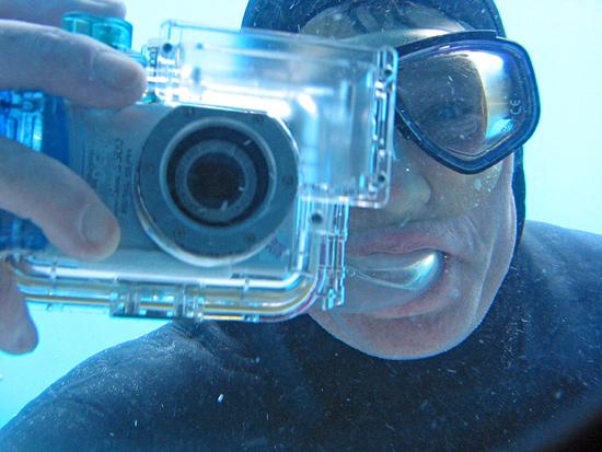 WHOI diver snapping photos of DSV Alvin crew through a view port.