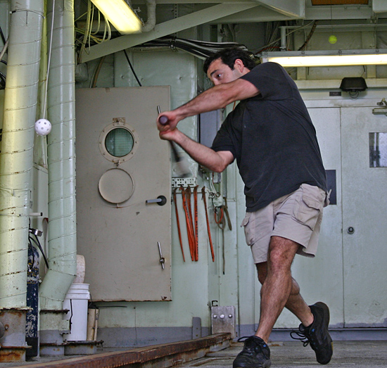 DSV Alvin pilot Anthony Tarantino practices for the summer baseball season aboard the R/V Atlantis.
