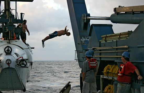 R/V Atlantis Steward Carl Wood leaps from DSV Alvin during launch.
