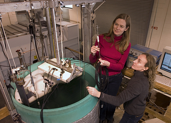 Tetjana Ross (in red) and Andone Lavery working with large test tank.
