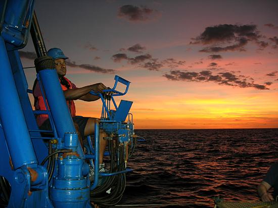 Thomas Anthony operating the crane aboard R/V Melville
