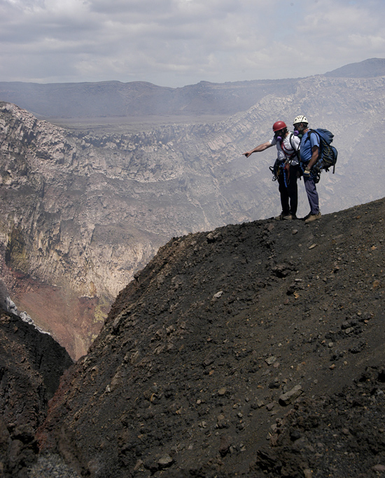 WHOI geochemist Ken Sims and climber Dennis Jackson overlooking Masaya volcano in Nicaragua.