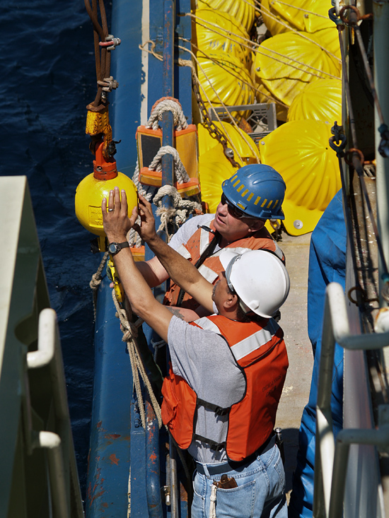 Ken Rand and Diego Mello (foreground) working on deck of R/V Oceanus.