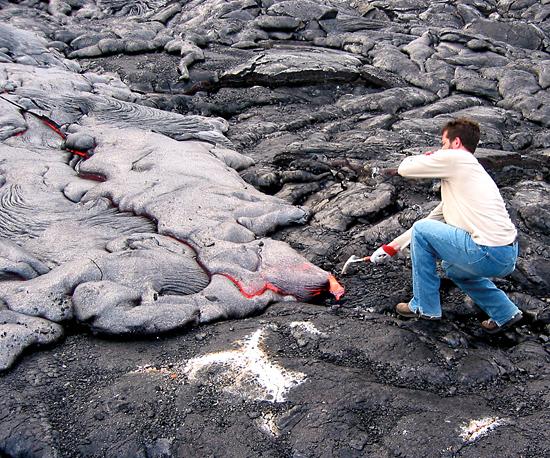 MIT/WHOI Joint Program student Matt Jackson working with lava.