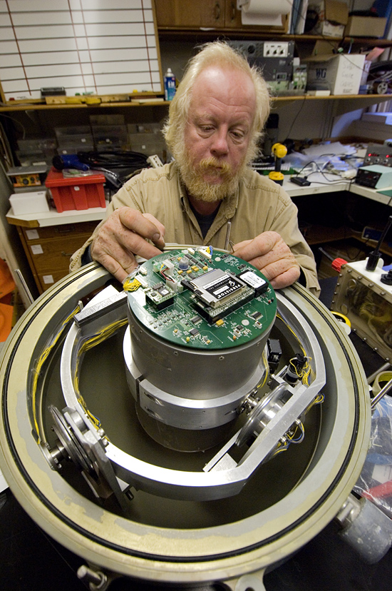 Victor Bender working on an ocean bottom seismometer (OBS).