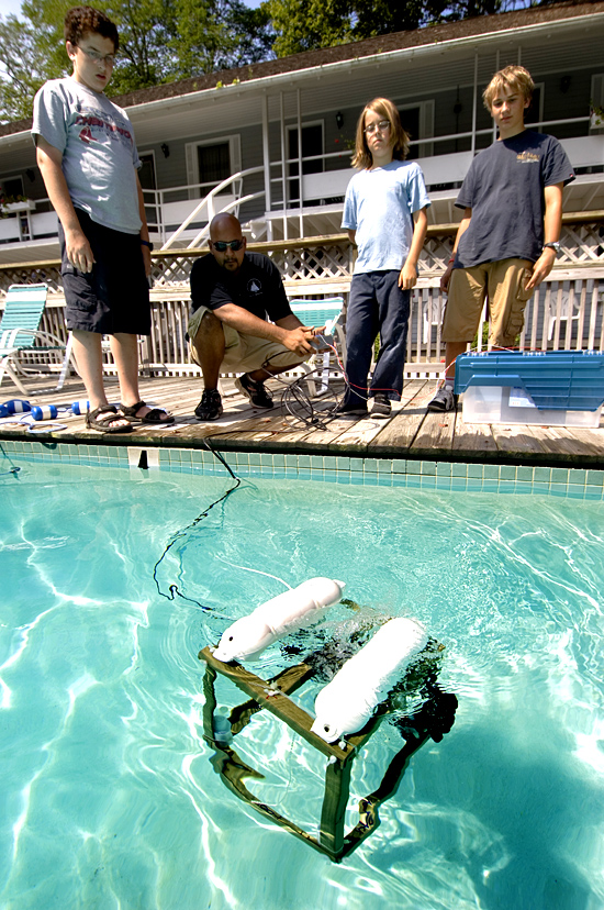Rick Rupan instructing students in ROV piloting.