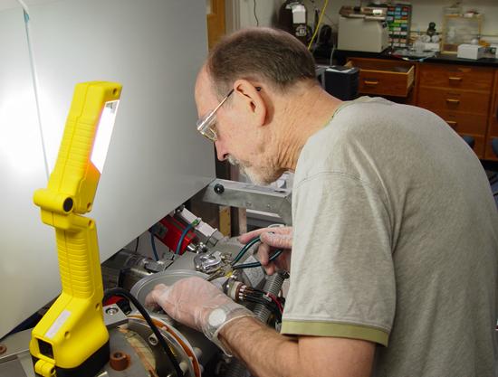 Dave Schneider working in lab.