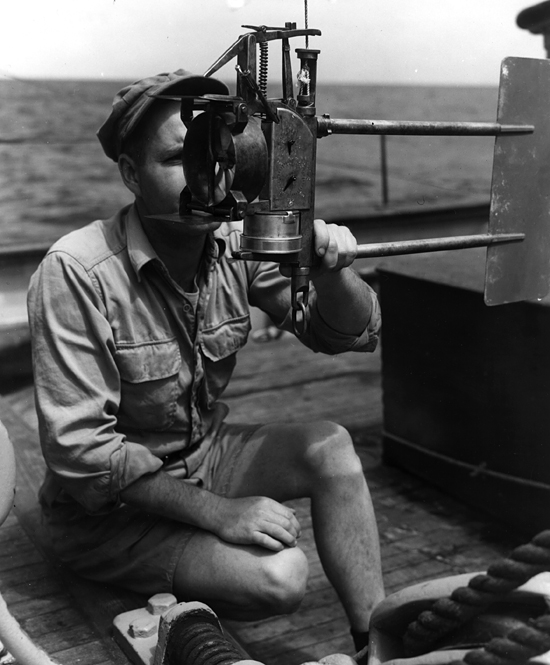 Reading a current meter onboard R/V Atlantis, circa 1931.