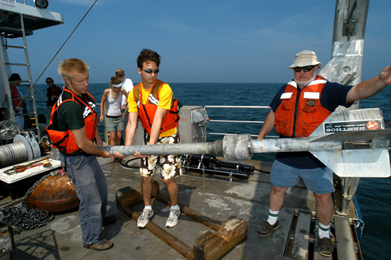 WHOI Summer Student Fellows learn coring techniques aboard the R/V Tioga.