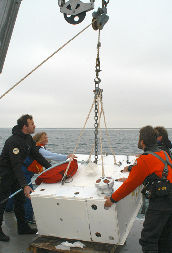 Scientists deploy an undersea node off the R/V Tioga near the ASIT tower of the MVCO.