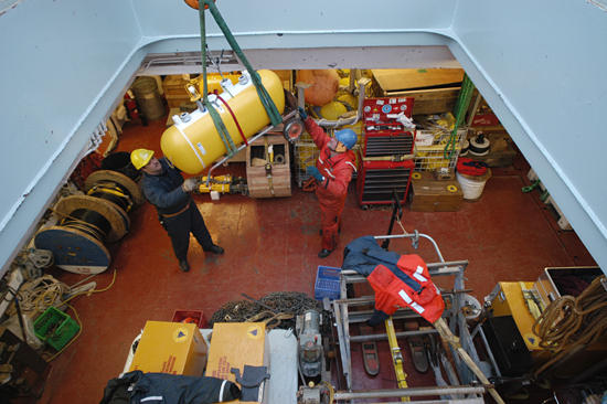 Equipment and data are delivered into the Canadian icebreaker  Louis S. St-Laurent's hold.