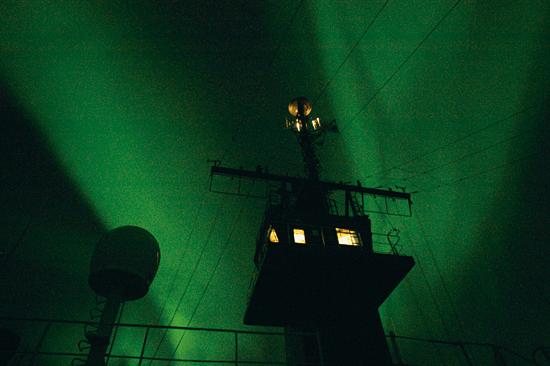 Aurora behind ship mast
