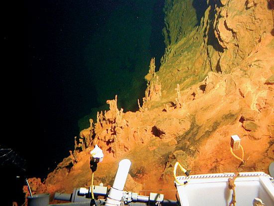 Reddish-orange iron oxide coats the seafloor on Loihi Seamount, an active underwater volcano 25 miles off the island of Hawaii.
