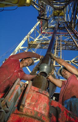 Rig floor personnel aboard JOIDES Resolution work round the clock