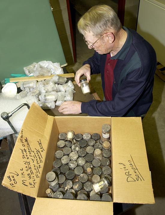 George LeRoy packs Mary Sears' Dana samples.