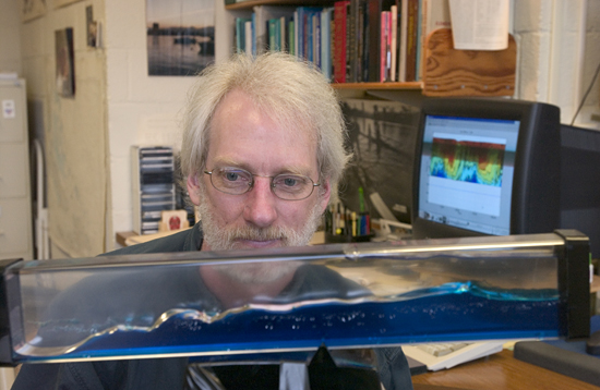 Scientist Tim Duda demonstrates with a wave tank what it is difficult to see in the ocean.