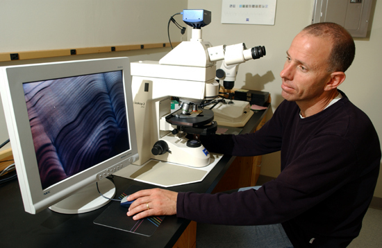 Simon Thorrold, at work in his lab at WHOI, heads the New Guinea project.
