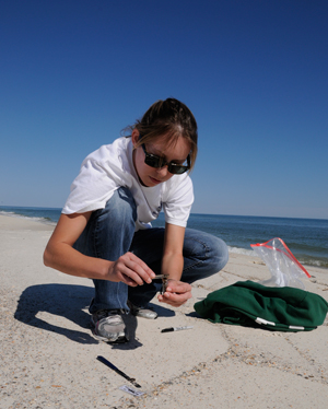 Catherine Carmichael collecting samples on the beach
