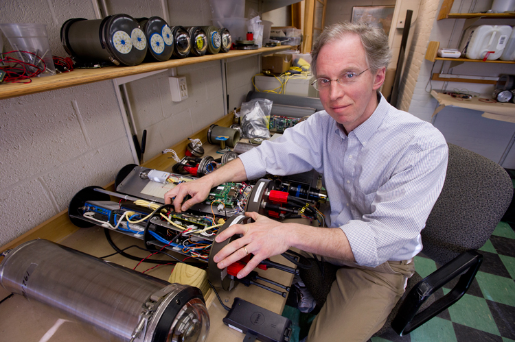 Norm Farr at his bench with the optical modem