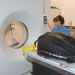 darlene ketten examines turtle at CT scanner