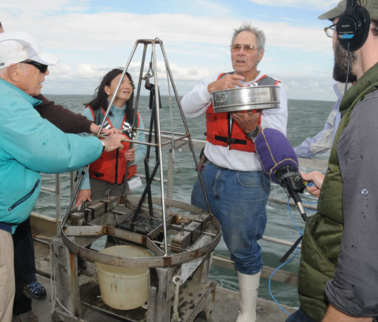 George Hampson shows samples to journalists aboard TIoga