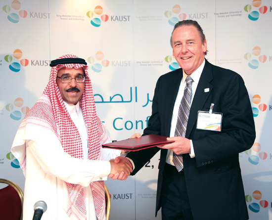 Nadhmi Al-Nasr and Jim Luyten (right) celebrate the signing of the joint research agreement between WHOI and the King Abdullah University of Science and Technology.