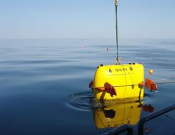 The autonomous underwater vehicle Sentry is lowered into the North Atlantic during deep-sea engineering trials in April 2008 on the research vessel Oceanus. (Photo by Chris German, Woods Hole Oceanographic Institution)